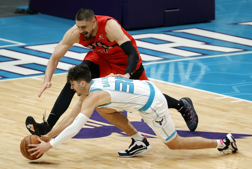 Bedford's Nate Darling of the Charlotte Hornets  battles for a loose ball against the Toronto Raptors in a pre-season NBA game on Monday. - Jared C. Tilton (NBA Photos/Getty Images)