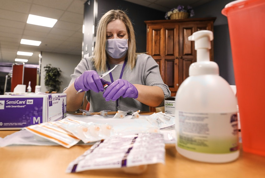 Northwood staff nurse Amanda Parsons prepares doses of the Moderna COVID-19 vaccine for long-term care residents at Northwood's Halifax campus on Monday, Jan. 11, 2021.