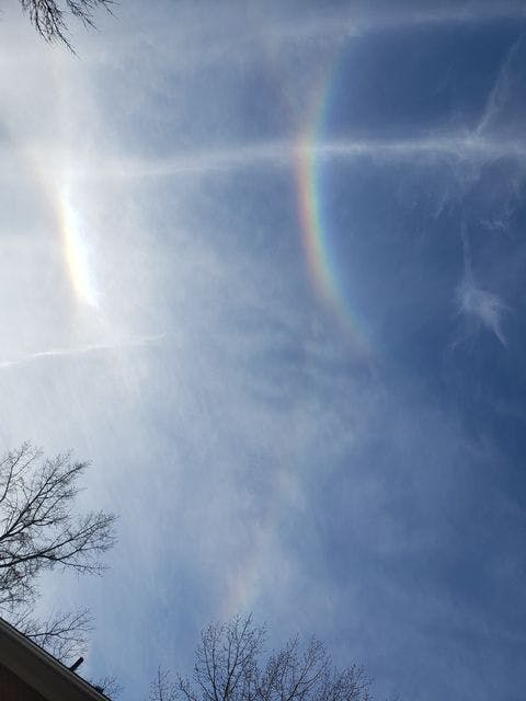 Aninfralateral arcis a rare halo, an optical phenomenon appearing similar to a rainbow under a white parhelic circle.