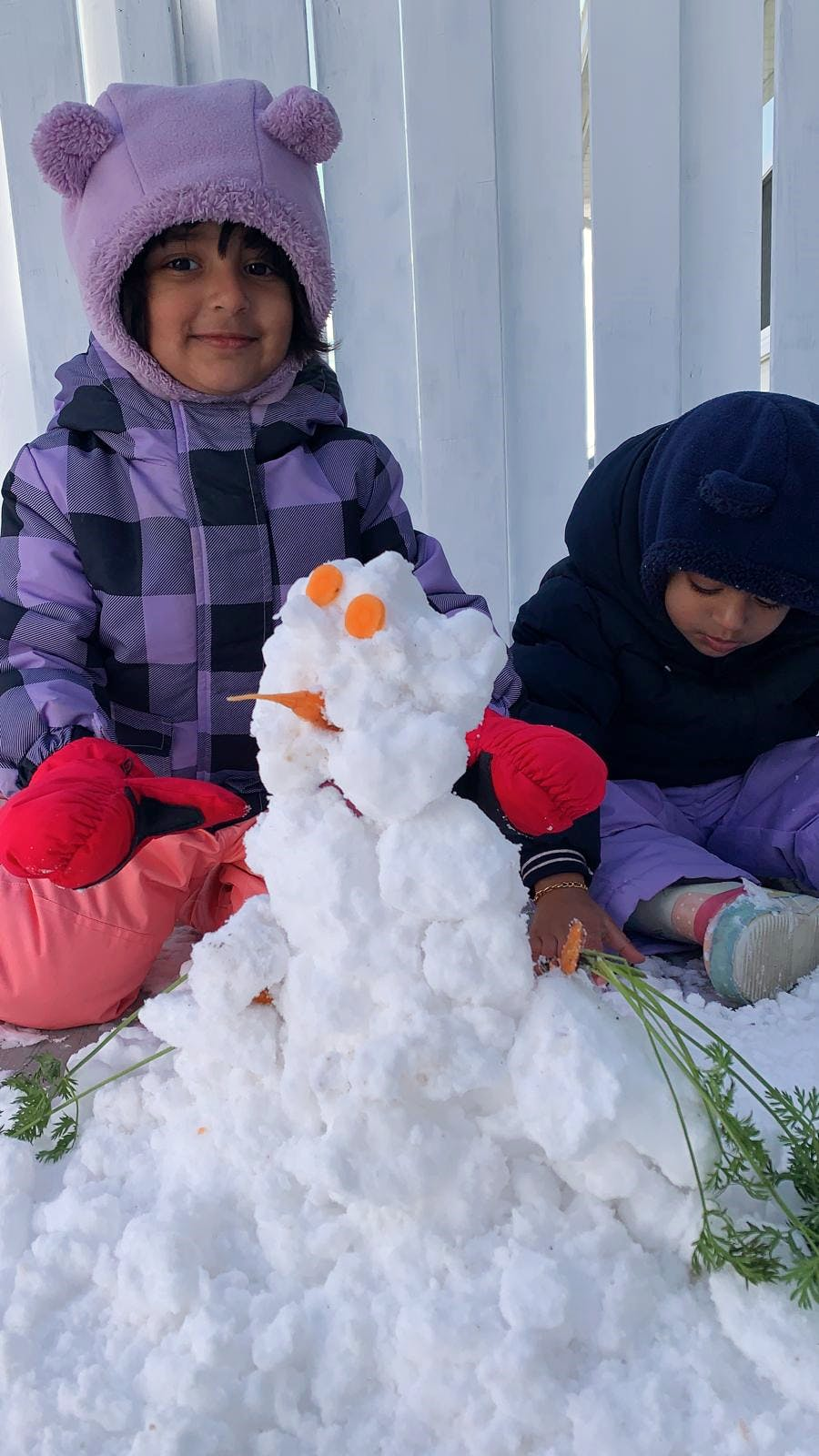 While last week's early snowfall caused chaos on the roads, it brought joy to the young and young at heart.  Two-year-old Joel Jaison Lukose was thrilled to see the snow whiten the landscape in Charlottetown on Tuesday and couldn't wait to try his hand at building a snowman.  His three and a half-year-old sister Hannah Maria gave her little brother a helping hand. That is a good-looking snowman! I'm sure there'll be many more!