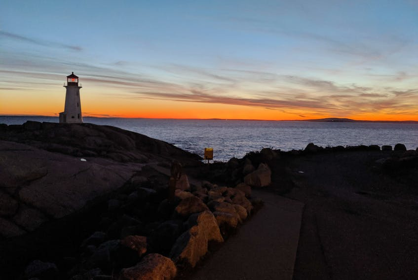 """This beauty truly is iconic. People come from far and wide to see and photograph the lighthouse at Peggy's Cove along Nova Scotia's south shore. Peter Simpson from Dayspring NS shares this magical photo taken by an old friend of his who was visiting from Australia.  Peter says: """"I don't think I've ever seen a Peggy's Cove photo with the light on in the lighthouse""""."""