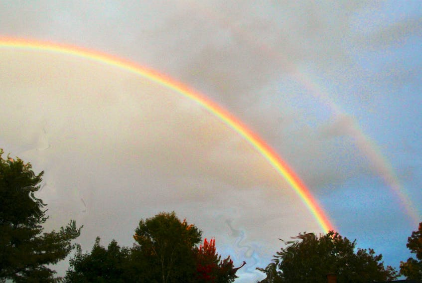 Well worth sharing.  Earlier this month, Lee Edgar's daughter called him to say that he should look outside.  This is what he saw over Cole Harbour, N.S.  The secondary bow is never as bright, but it's always a treat to spot one.
