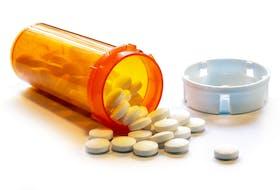 Open Bottle of Prescription Painkiller Pills