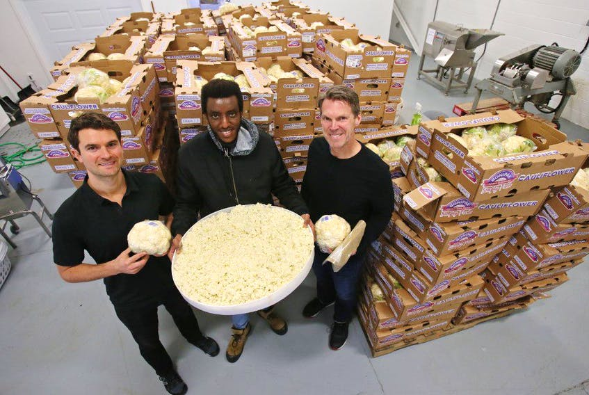 Outcast Foods chief marketing officer TJ Galiardi, employee Gary Chelsea and CEO Darren Burke are seen with trays of cauliflower, otherwise destined for the landfill, which the the company upcycles. Outcast takes the surplus of fruit and vegetables and turn them into high value, long shelf life, whole-plant powders. TIM KROCHAK/ The Chronicle Herald