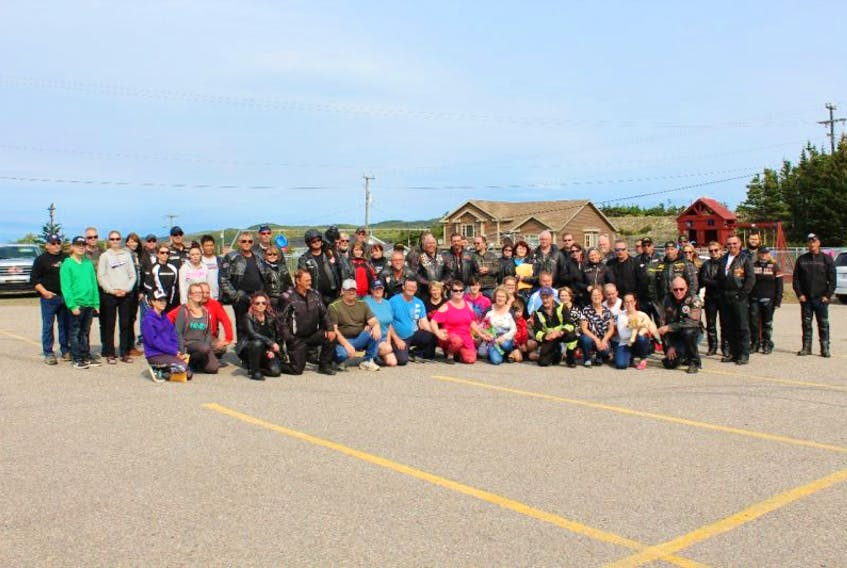 A groupo shot of the riders and members of both the Vivian family and Ryan family.