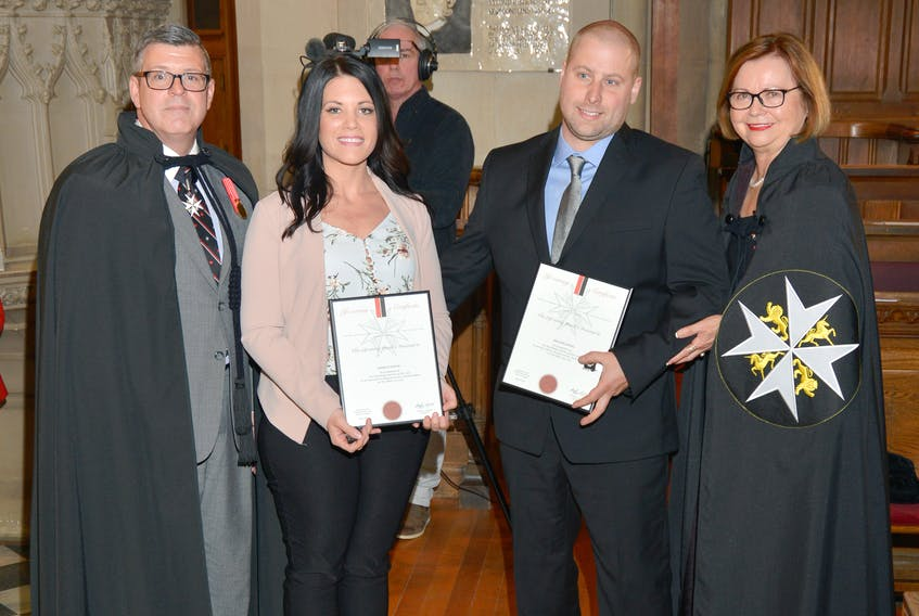 From left to right, St. John Ambulance Deputy Chancellor Alain Laurencelle, Giselle Young, Trevor Young and Lieutenant Governor Judy Foote in St. John's on May 23. DALE POWER PHOTO