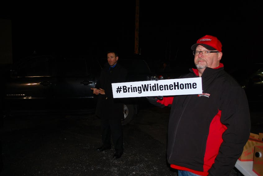 Shawn Hart brought along a sign reading #BringWidleneHome, hoping to draw the attention of the Prime Minister.