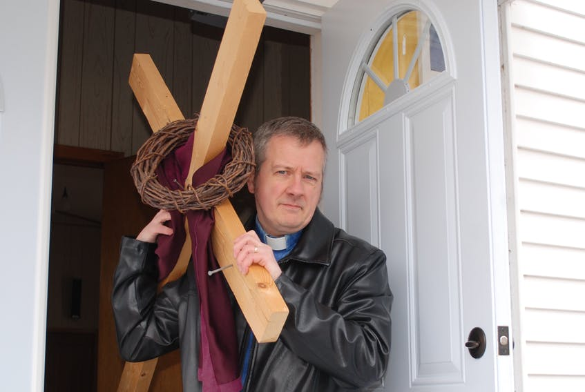 Reverend Bob Mercer ahead of his trek from Deep Bight to Clarenville, carrying a cross in recognition of Good Friday. He has been the minister at the Clarenville and Deep Bight churches for the last seven years.