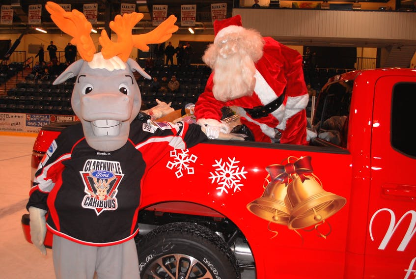 'Bou' and Santa pose at the annual Teddy Toss at Sunday's Clarenville Ford Caribous game at the Eastlink Events Centre.