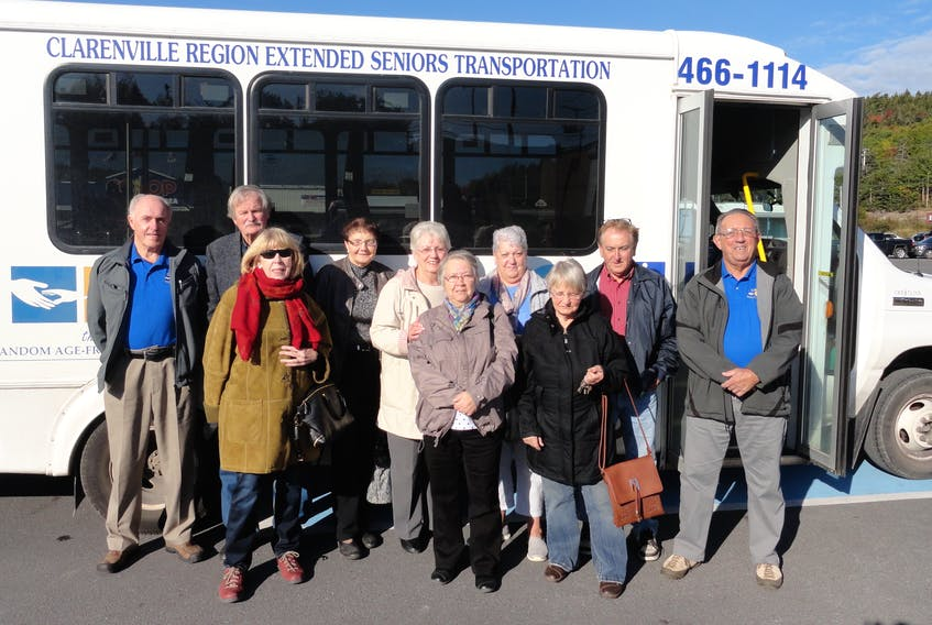 Photo courtesy of Random Age-Friendly Communities Twin Towns 50+ Club members together with volunteer driver Ches Stanford and assistant Ed Hiscock pose for a photo before boarding the CREST bus to Champney's West Aquarium.
