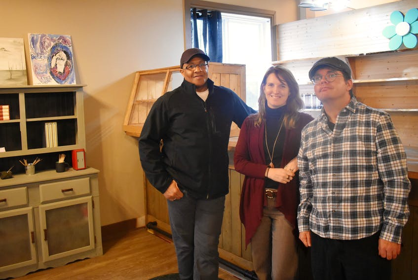 Riverview Home Corporation staff member, Dana Lee, Social Enterprise Coordinator, Jocelyn Tye and resident Timothy MacDonald standing inside a new cafe opened by the local non-profit right in downtown New Glasgow. The new cafe, which will be open sometime in March, will be called The River Run Cafe.