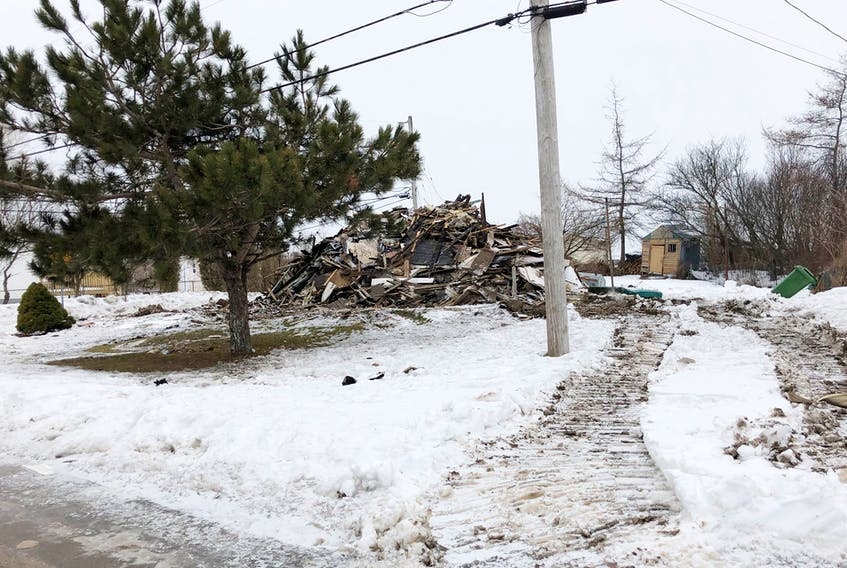 Nothing but a pile of rubble remained on Feb. 10 after a house that was damaged by fire on Feb. 7 was levelled.