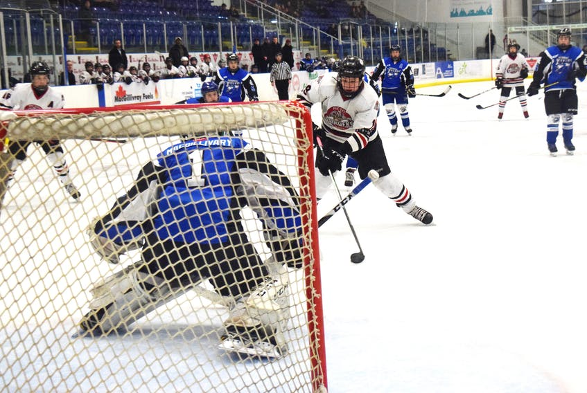 Seth Gallant of the Pictou County Bantam AA Crushers crashes the net at the annual Bantam Memorial tournament on Feb. 7. On Feb. 9, Gallant would score the only game of the championship game as the Bantam AAs claimed a gold medal over the Dartmouth Whalers.