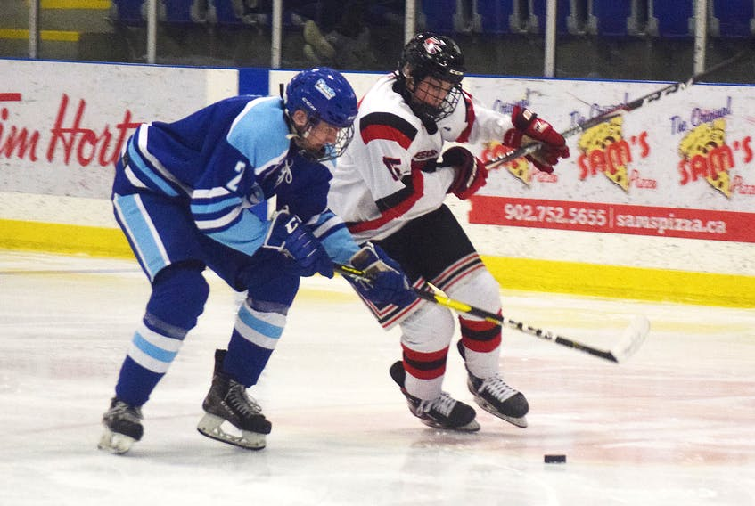 Landon Sim of the Pictou County Weeks Major Midgets goes on the rush against Dartmouth Steele Subaru on a Feb. 9 playoff game.