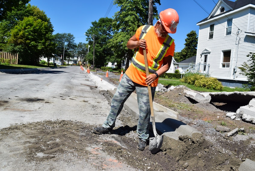 Weeks Construction employee Gordon Malcom does some cleanup work on Jubilee Avenue in Stellarton on Aug. 14.