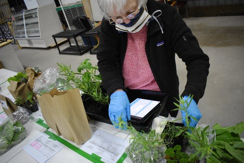 Bonnie Quinn of the Lochabor Growers Cooperative fulfilling her week's orders at the Antigonish Farmers' Market on May 9.