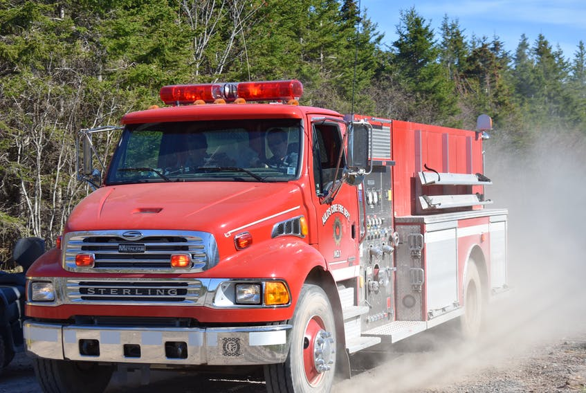 Multiple fire departments respond to a forest fire in Antigonish County, on May 25, 2020.