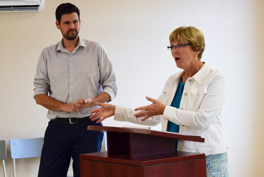 Carol Robertson, with the Pictou County Community Orchestra shares a bit about how New Horizons funding will help their organization as Central Nova MP Sean Fraser listens.