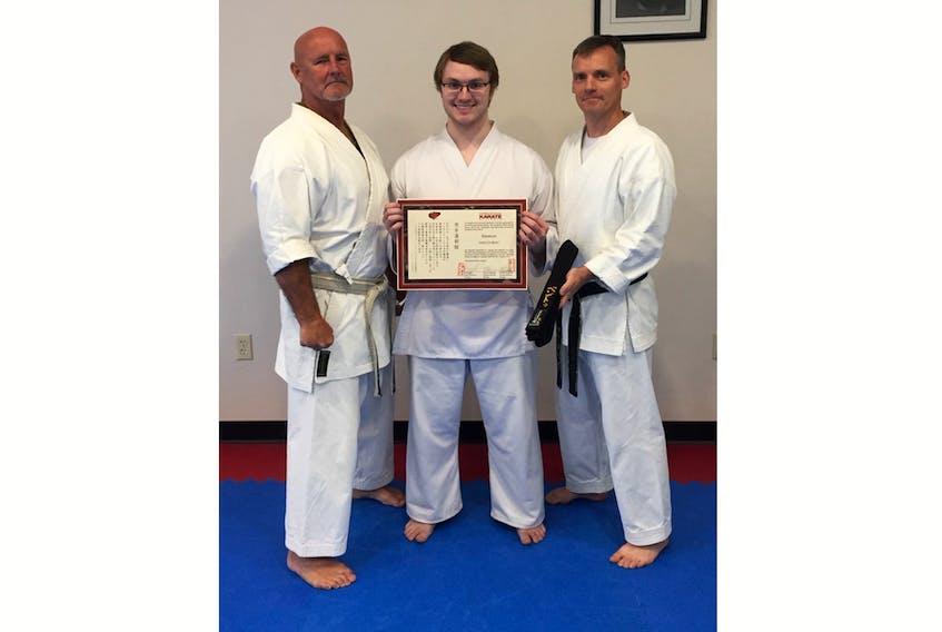 Gaelen Bent of Trenton (middle), with Sensei Ron Fagan (left) and Sensei Chris Cruikshank (right) received his 1st Degree black belt on Aug. 25.