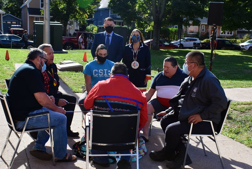 Chief Junior Gould, second from left, drums and sings with the Red Stone drummers, while in the back Premier Dennis King and chief Darlene Bernard listen along to mark the end of the Treaty Day ceremony on Oct. 1.