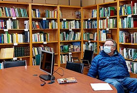 Tony Dolan, a board member with the Benevolent Irish Society and a library volunteer, takes a break from cataloguing and shelving volumes in the recently opened library located in the Irish Cultural Centre in Charlottetown.