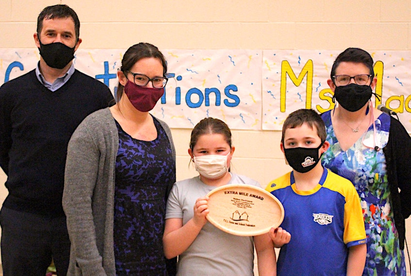 Norbert Carpenter, left, director, Public Schools Branch, is shown with Melissa MacKinnon, vice-principal and teacher at Mounts Stewart Consolidated School, a recipient of this year's Extra Mile Award. Also on hand for the presentation were Breigh Rogerson and Hayden Charlton, both Grade 4 students in MacKinnon's class, and Heather Mullen, right, president of the P.E.I. Home and School Federation.