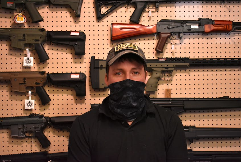 Andy Hardy, owner of Andy's Airsoft in Charlottetown, stands in front of a display of some of the airsoft guns he sells. If Bill C-21 were to become law, they would all be illegal for Hardy to sell, effectively ending his business.