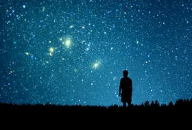 A man looks looks at the starry sky.