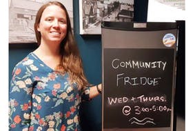 Krystal Dionne, a branch technician with the Montague Rotary Library, located in the Cavendish Farms Wellness Centre, poses with the new community fridge. People can come take a variety of food from the fridge at no cost on Wednesdays and Thursdays between 3 and 5 p.m.