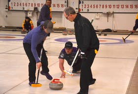 Tyler Smith, third with the Eddie MacKenzie rink, releases a shot while lead Ryan Lowery, left, and second Sean Ledgerwood handle the sweeping. The action took place during the Tankard P.E.I. men's curling championship in O'Leary in January. Team MacKenzie defeated the Blair Jay rink from the Silver Fox in Summerside 3-0 to win the best-of-five series and earn P.E.I.'s berth in the Tim Hortons Brier Canadian men's curling championship in Calgary, March 6-14.
