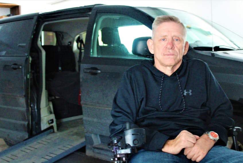 Paul Cudmore's wheelchair accessible van broke down in January. He wants the city of Charlottetown to mandate accessible taxis so to avoid situations like the one he had.
