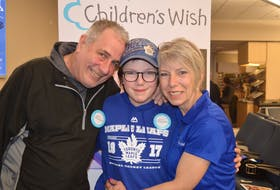 Kara MacRae, centre, of Orwell is one of the 1,100 children whose wishes were granted by the Children's Wish Foundation of Canada this past year. On Thursday, the national organization announced it is merging with Make A Wish Canada. Also pictured are Kara's parents, Donnie MacRae and Violet Robinson.