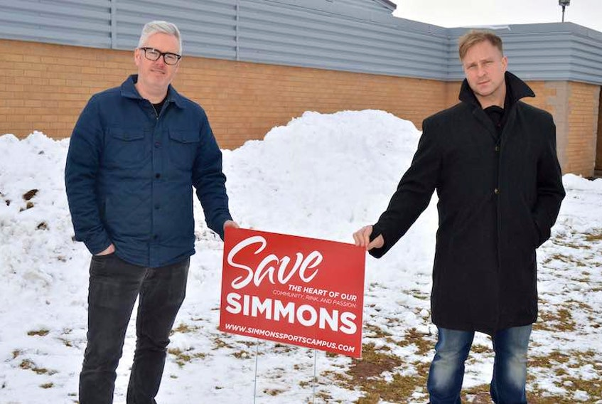 Mark Fisher, left, and Olin Penna, are members of a community group still trying to save Simmons Sport Centre from the wrecking ball in Charlottetown.