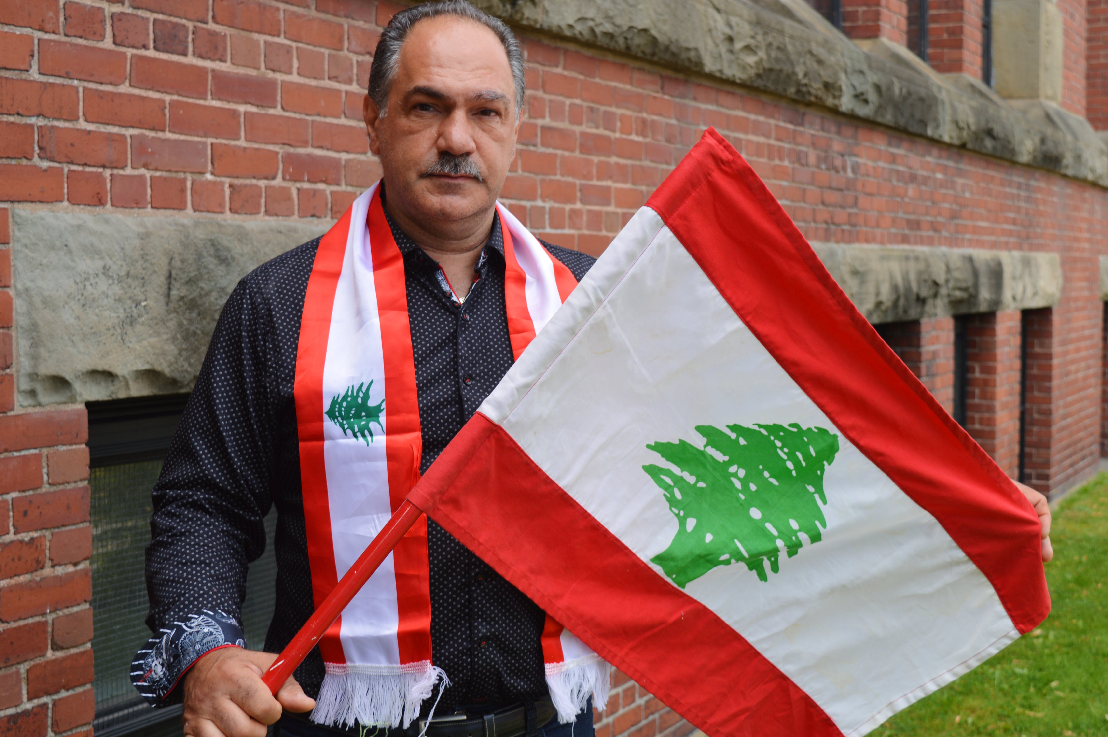 Paul Haddad, one of the many Lebanese residents living in Charlottetown, displays the Lebanese flag in a sign of solidarity following the devastating explosion that rocked Beirut on Tuesday.