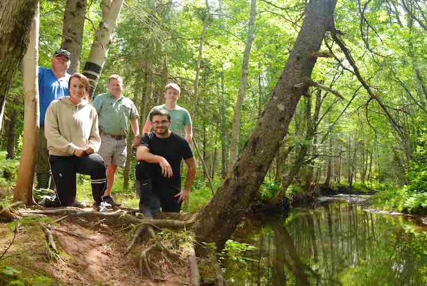 Roseville/Miminegash  Watersheds Inc. co-ordinator Danny Murphy, left, is joined by his team, daughter and staff member Carrie-Jane Murphy, board member Dennis Rix, summer students Daniel Gavin and Jacob Delaney at the edge of the Miminegash River.