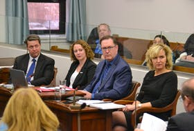 Education Minister Brad Trivers, left, makes a presentation to the standing committee on education and economic crowth on Tuesday. Also presenting were Becky Chaisson of the Public Schools Branch, as well as John Cummings and Bethany MacLeod of the Department of Education.