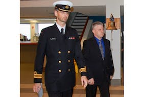 Todd Bannister, right, heads into military court Tuesday with his defence lawyer Lt.-Cmdr. Brent Walden.