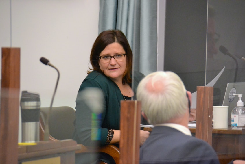 Green Education critic Karla Bernard speaks to Opposition Leader Peter Bevan-Baker before a sitting of the legislature. On Friday, Bernard raised questions about vacancies within the student wellbeing teams, which provide supports for youth in P.E.I. schools.