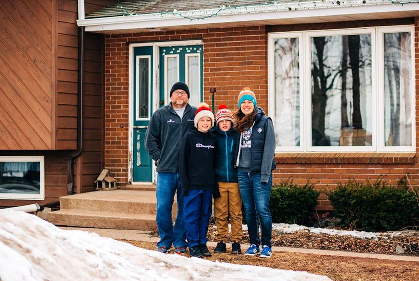 Derek and Jen Campbell with twins Ben and Jake took up the offer for a Front Step Project portrait by Kolby Perry on March 30.  - Kolby Perry/Special to The Guardian