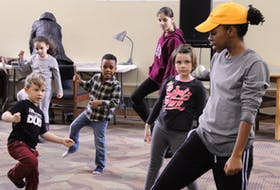 Reequal Smith, right, teaches youth a coordinated dance during a Black History Month event at the Confederation Centre Public Library in Charlottetown on Feb 8.