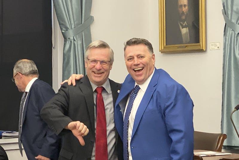 Liberal MLA Robert Henderson and Premier Dennis King joke around prior to question period at the P.E.I. legislature in November 2019. - SaltWire file