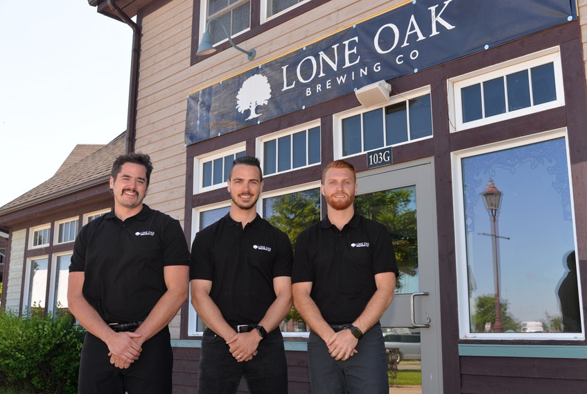 Lone Oak Brewing Co. in Borden-Carleton is one P.E.I. brewery that wants the $0.25 per litre tax on beer sales scrapped. In this photo from 2019 are co-owners Spencer Gallant, left, Jared Murphy, centre, and Dillon Wight. - SaltWire File Photo
