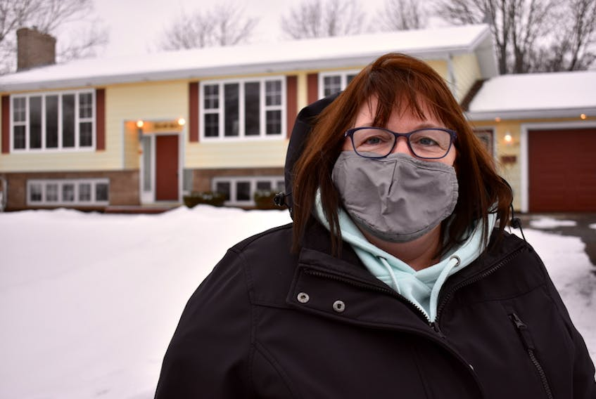 Anne Quinn stands in front of the house on Enman Crescent in Charlottetown she thought she was going to be renting, until she found out she was the victim of a rental scam.