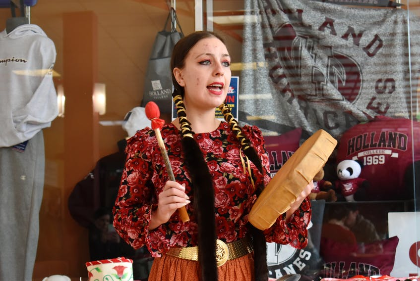 Starr Bennett drumming and singing a traditional Mi'kmaq honour song to start Holland College's Diversity Fair on March 9. Bennett works at the Native Council of P.E.I. as the Telling Our Stories Coordinator and uses education through events like this is the best way to fight racism.