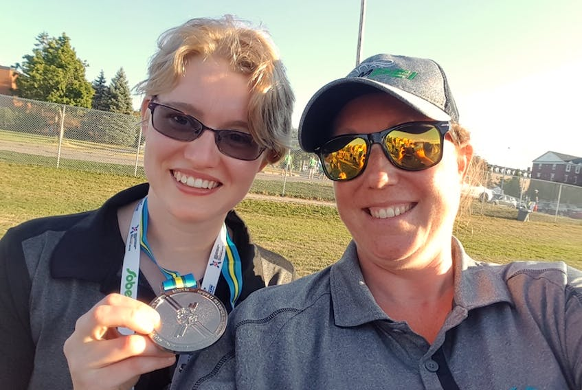 Special Olympics P.E.I. executive director Charity Sheehan, right, poses with athlete Ellen MacNearney during the 2018 Special Olympics Canada National Summer Games in Antigonish, N.S. Sheehan has been named Team Canada's chef-de-mission for the 2022 Special Olympics World Winter Games in Russia.