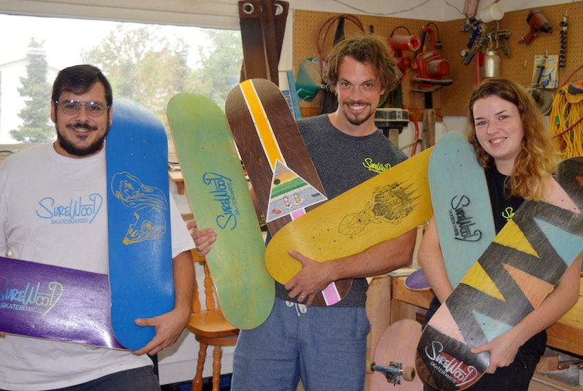 Three Charlottetown entrepreneurs have launched P.E.I.'s first skateboard manufacturing business. From left are Jeffrey Lockert, Jamie Crawford and Emily Cornish.