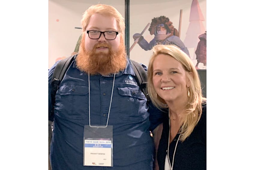 Product director Ryan Hale, left, and Deirdre Ayre, head of Canadian operations of Other Ocean Interactive, attend the Tokyo Game Show in 2019 to show off Project Winter.