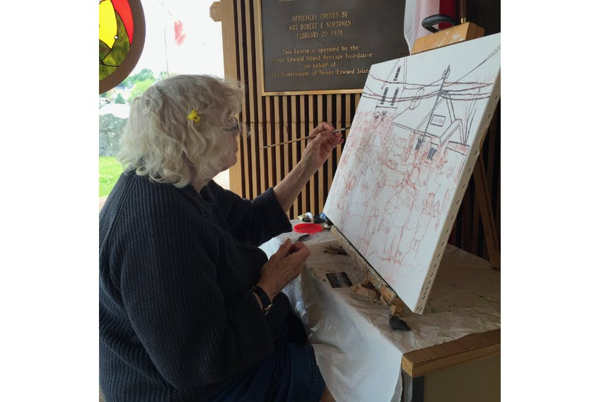 Nan Ferrier is shown at work on a recent piece of art. Her work will be featured in an exhibit that opens Sunday at Eptek Centre in Summerside.