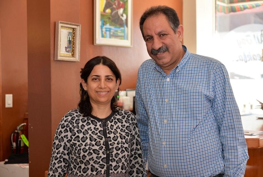 Seyedazim Sharif and his wife Zeynab inside Linda's Coffee Shop and Restaurant on Thursday.