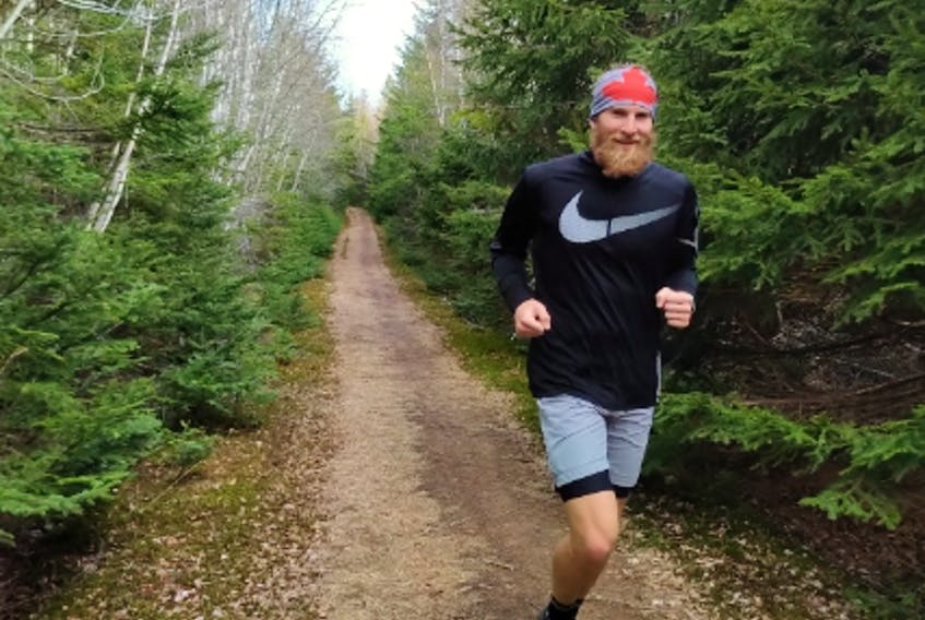 Jason Simmons runs on Gairloch trail in this family photo. Contributed.